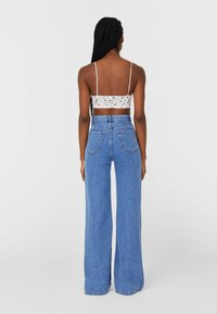Stradivarius - Flared jeans - blue - 2