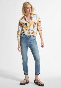 comma - Slim fit jeans - light-blue denim - 1