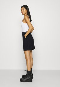 Calvin Klein - DOUBLE FACE SKIRT - Mini skirt - black - 4