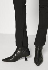 ARKET - Kalhoty - black - 4