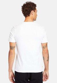 Timberland - T-shirt med print - white - 2
