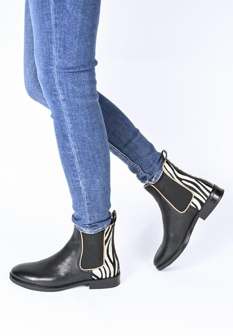 Crickit - Classic ankle boots - schwarz zebra