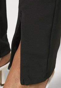 Gina Tricot - JADA SLIT - Leggings - Trousers - black - 4