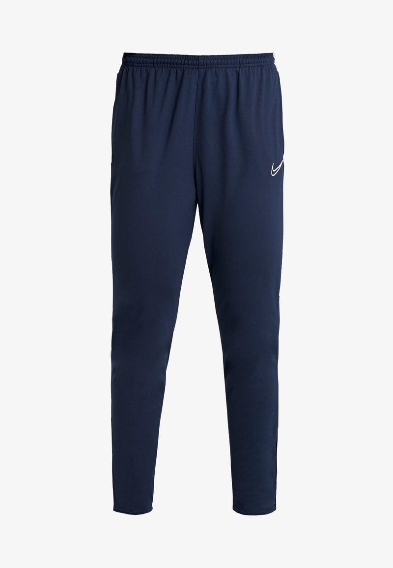 local Escuchando persona que practica jogging  Nike Performance DRI-FIT ACADEMY19 - Pantalon de survêtement -  obsidian/white/bleu marine - ZALANDO.FR