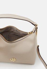 DKNY - CAROL MINI POUCHETTE - Handbag - eggshell - 2