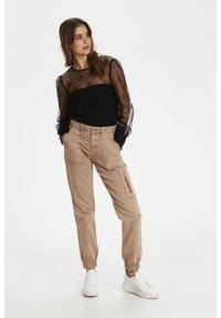 Cream - Slim fit jeans - cognac - 1