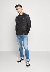 Tommy Jeans - LIGHT JACKET - Down jacket - black - 1
