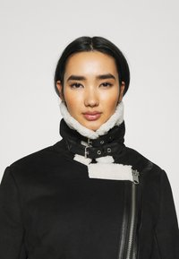 ONLY - ONLDIANA BONDED AVIATOR JACKET - Faux leather jacket - black/white - 3