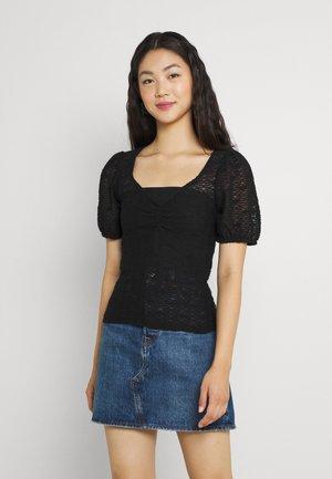 PCFLORI V-NECK - T-shirts med print - black