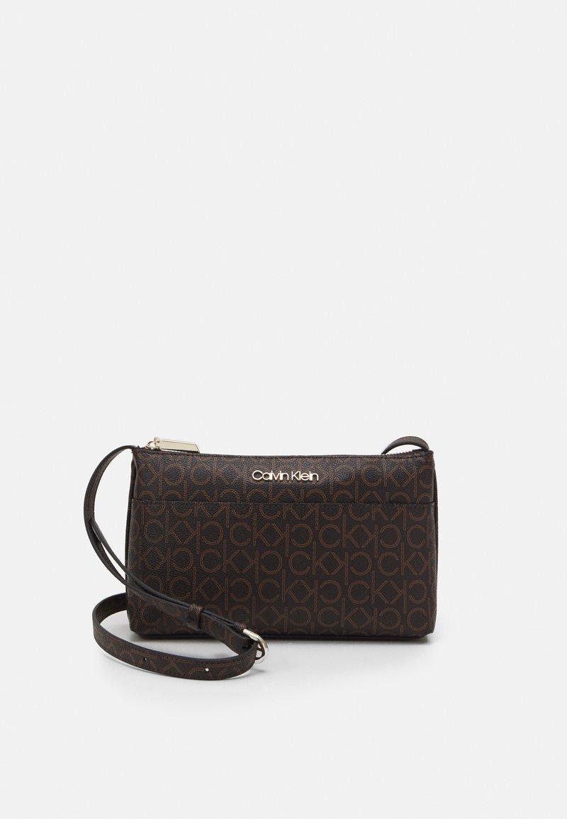 Calvin Klein - XBODY MONOGRAM - Taška spříčným popruhem - brown