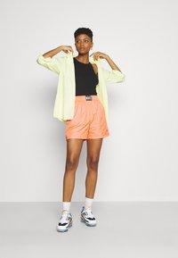 Nike Sportswear - Shorts - atomic orange/black - 1