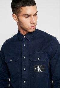 Calvin Klein Jeans - ARCHIVE ICONIC UTILITY SHIRT - Shirt - blue - 5