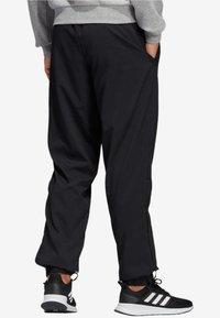 adidas Performance - ESSENTIALS PLAIN STANFORD TROUSERS - Spodnie treningowe - black - 1