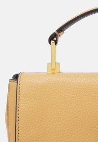 Coccinelle - LIYA - Handbag - warm beige/noir - 5