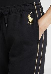 Polo Ralph Lauren - SEASONAL  - Pantalon de survêtement - black - 6