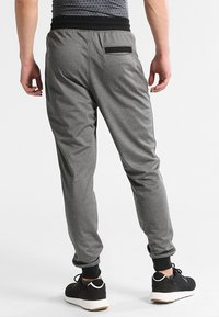 Under Armour - SPORTSTYLE - Tracksuit bottoms - carbon heather - 2