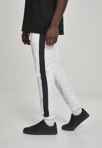 Urban Classics - Tracksuit bottoms - white, black - 4