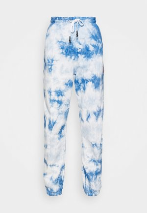 PLAYBOY TIE DYE - Tracksuit bottoms - blue
