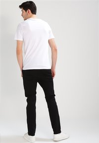 Jack & Jones - JJIMARCO JJENZO - Trousers - black - 2