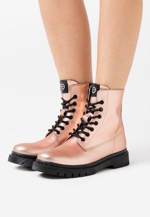 BOOTS - Platform ankle boots - rose metallic