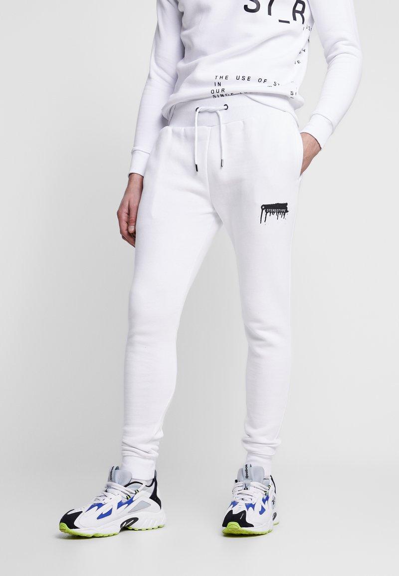STEREOTYPE - Teplákové kalhoty - white