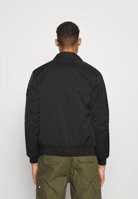 Calvin Klein Jeans - HARRINGTON PADDED JACKET - Light jacket - black - 2