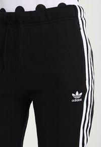 adidas Originals - ADICOLOR REGULAR CUF - Træningsbukser - black - 4