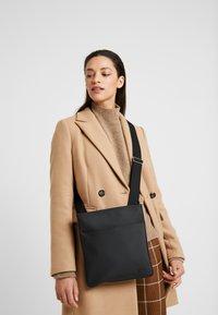 Lacoste - FLAT CROSSOVER BAG - Across body bag - black - 6