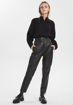 Spodnie skórzane - caviar