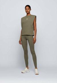BOSS - ERINA - Leggings - Trousers - dark green - 1