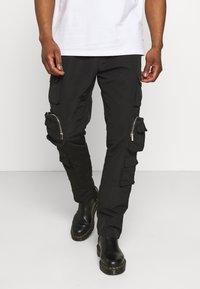Mennace - MENNACE UTILITY TROUSER - Cargo trousers - black - 0
