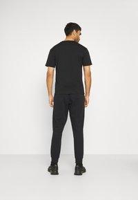 Calvin Klein Performance - PANT - Teplákové kalhoty - black - 2
