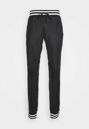 COLE - Tracksuit bottoms - black