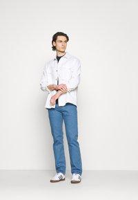 Levi's® - 501 ORIGINAL FIT UNISEX - Jeans a sigaretta - light indigo flat finish - 1