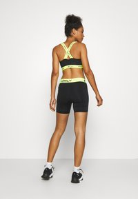ONLY Play - ONPALIX SHAPE UP TRAINING SHORTS - Tights - black/safety yellow - 2