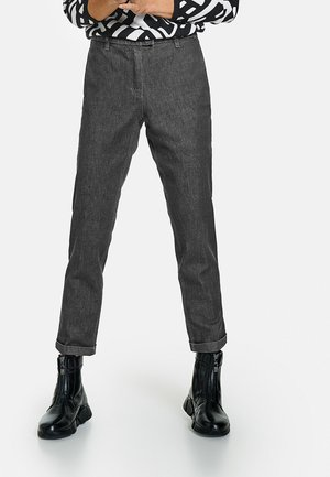 VERKÜRZT 7/8 CITYSTYLE DRY INDIGO - Slim fit jeans - black denim