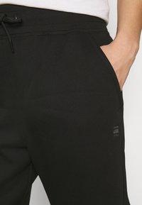 G-Star - PREMIUM TAPERED PANT - Tracksuit bottoms - black - 4