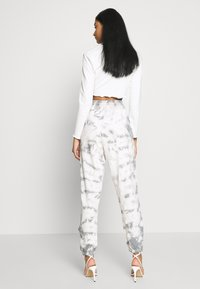 Missguided - TIE DYE  - Tracksuit bottoms - cream - 2