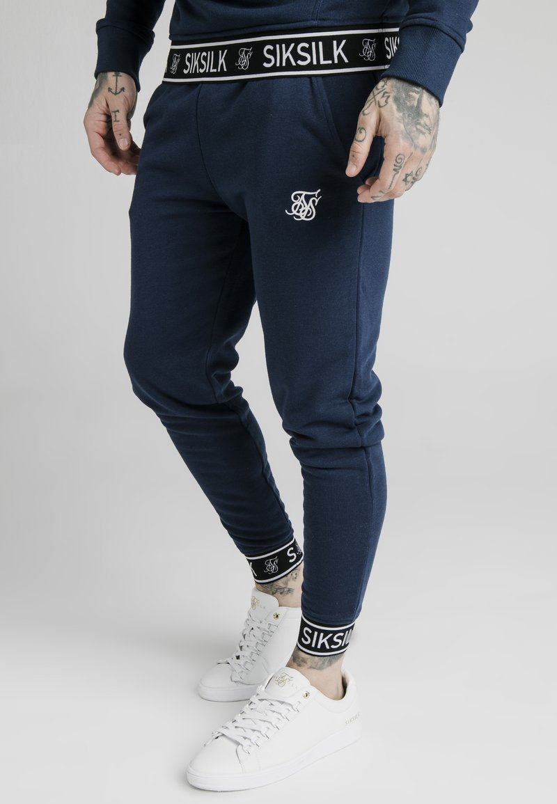 SIKSILK - MUSCLE FIT TAPE CUFF JOGGER - Tracksuit bottoms - navy