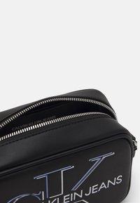Calvin Klein Jeans - CAMERA BAG GLOW - Across body bag - black - 2