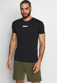 Jack & Jones Performance - JCOZSS TEE - Basic T-shirt - black - 0