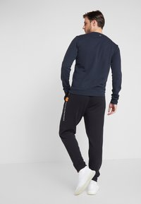 Calvin Klein Performance - PANTS - Tracksuit bottoms - black - 2