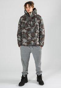 K1X - URBAN - Winter jacket - woodland camo - 1