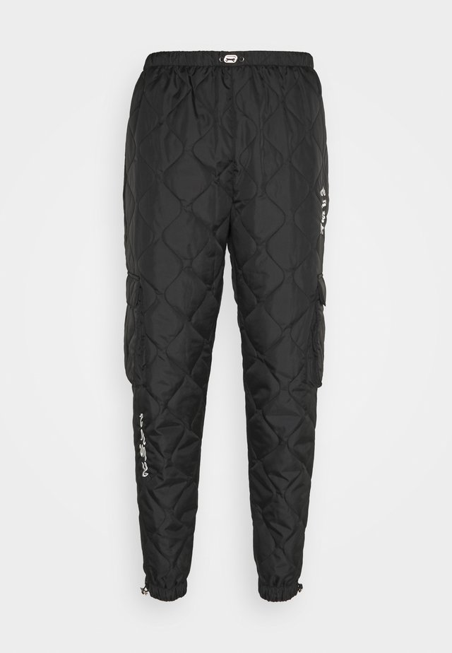 FIRE PADDED PANTS - Trousers - black