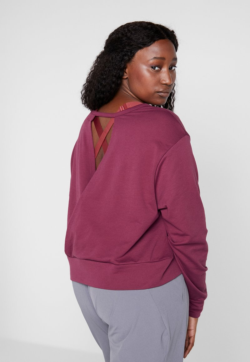 Nike Performance - YOGA WRAP COVERUP PLUS - Sweatshirt - villain red/shadowberry