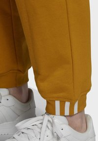 adidas Originals - Tracksuit bottoms - legacy gold - 5