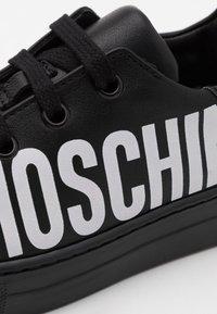 MOSCHINO - UNISEX - High-top trainers - black/white - 5