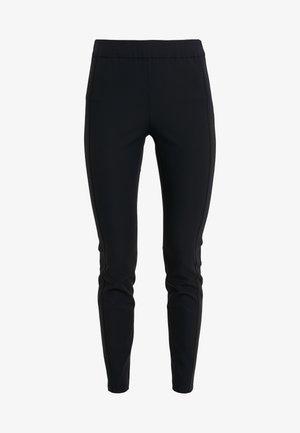 SALUNGI - Trousers - black