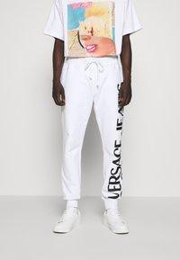 Versace Jeans Couture - BIG LOGO JOGGERS - Trainingsbroek - white - 0