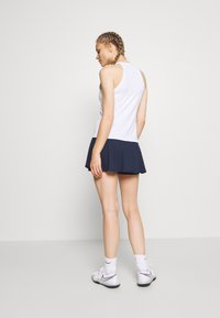 Nike Performance - FLOUNCY SKIRT - Sportovní sukně - obsidian/white - 2